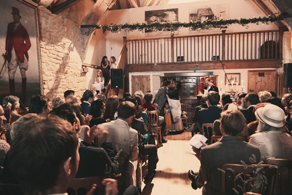 A wedding ceremony at Owlpen Manor wedding venue in Glouestershire