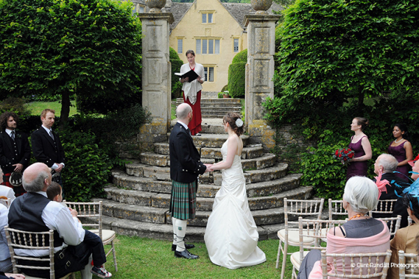 An outdoor ceremony at Owlpen Manor wedding venue in Glouestershire