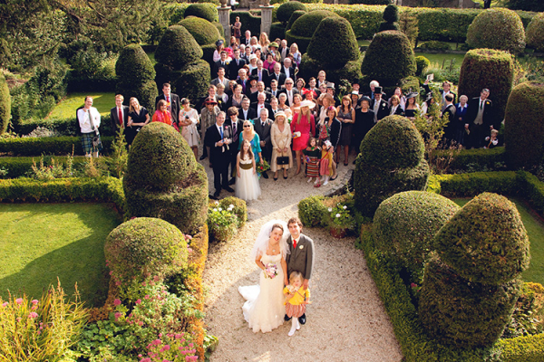A group photo in the grounds at Owlpen Manor wedding venue in Glouestershire