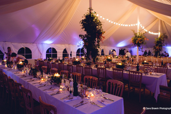 An evening reception in the marquee at Owlpen Manor wedding venue in Glouestershire
