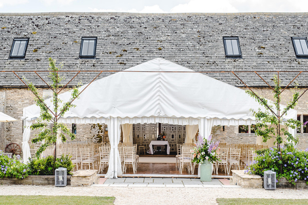 Set up for an outdoor ceremony at Oxleaze Barn wedding venue in Gloucestershire | CHWV