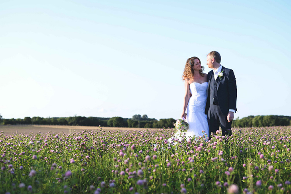 A happy couple in the grounds at Oxleaze Barn wedding venue in Gloucestershire | CHWV