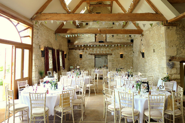 Set up for a wedding breakfast at Oxleaze Barn wedding venue in Gloucestershire | CHWV