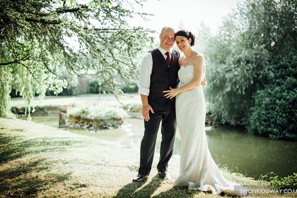 A happy couple in the grounds at Oxleaze Barn