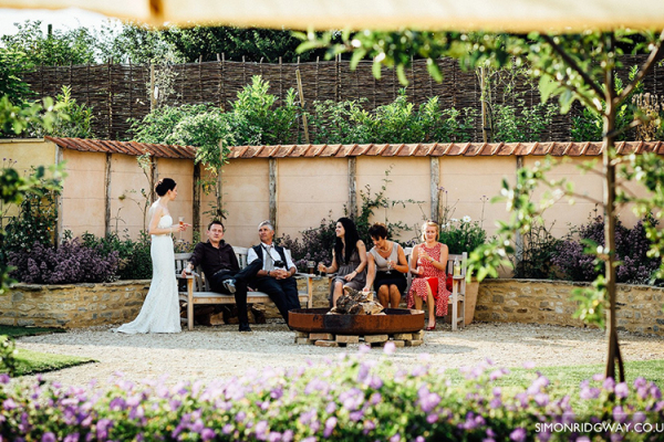 A wedding party in the grounds at Oxleaze Barn