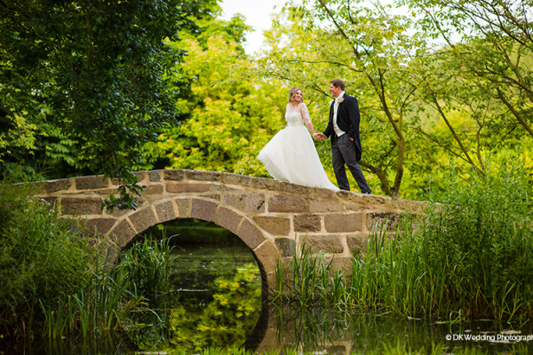 A happy couple in the beautiful gardens at Oxnead Hall wedding venue in Norfolk | CHWV