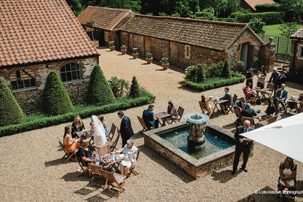 Outdoor wedding drinks reception at Oxnead Hall wedding venue in Norfolk | CHWV