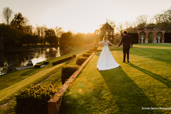 A happy couple taking a moment in the gardens at Oxnead Hall wedding venue in Norfolk | CHWV