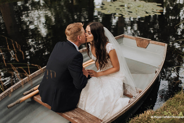 A happy couple taking a moment in the boat at Oxnead Hall wedding venue in Norfolk | CHWV