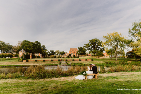 A happy couple taking a moment by the lake at Oxnead Hall wedding venue in Norfolk | CHWV