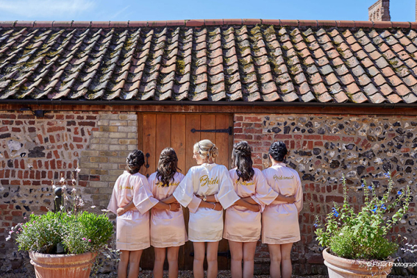 A bride and her bridesmaids at Oxnead Hall wedding venue in Norfolk | CHWV