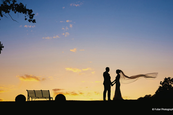 A couple take a moment as the sun sets at Oxnead Hall wedding venue in Norfolk | CHWV
