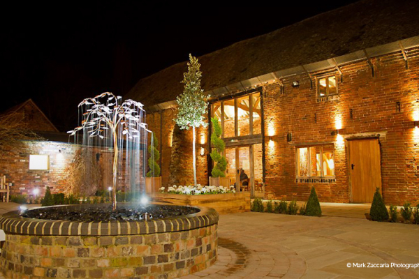 The courtyard at night at Packington Moor