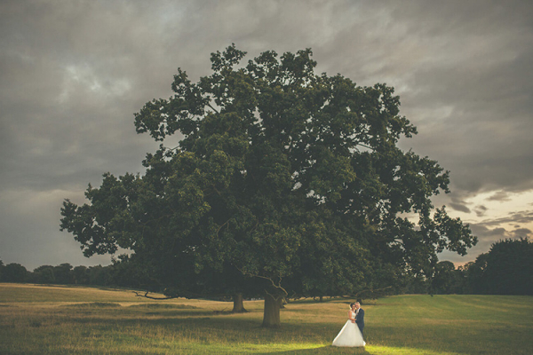 A couple sharing a moment in the grounds at Parklands wedding venue in Essex | CHWV