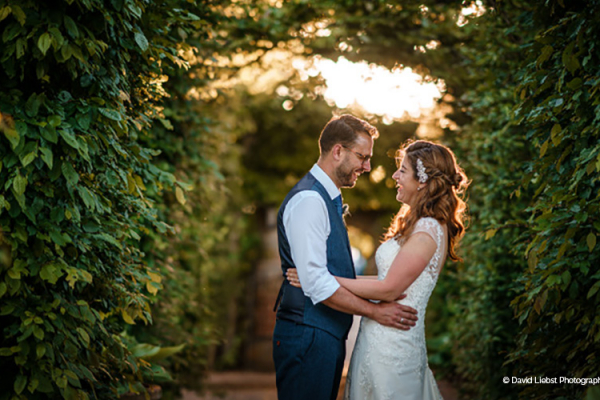 Couple take a moment in the cloisters at Pauntley Court country house wedding venue in Gloucestershire | CHWV