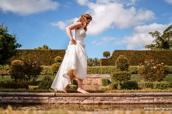 A barefoot bride at Pauntley Court country house wedding venue in Gloucestershire | CHWV