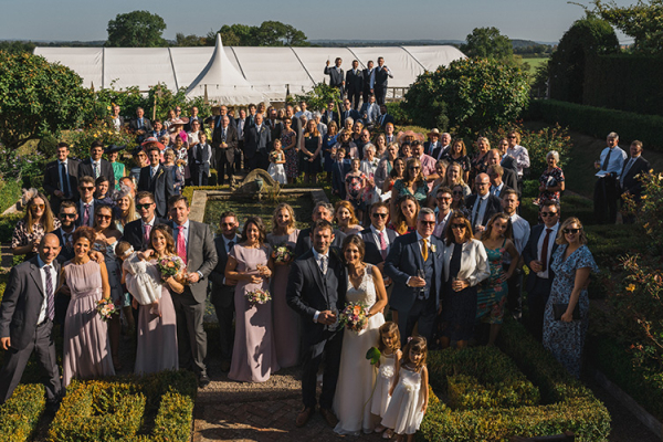 Guests in the sunken garden at Pauntley Court country house wedding venue in Gloucestershire | CHWV