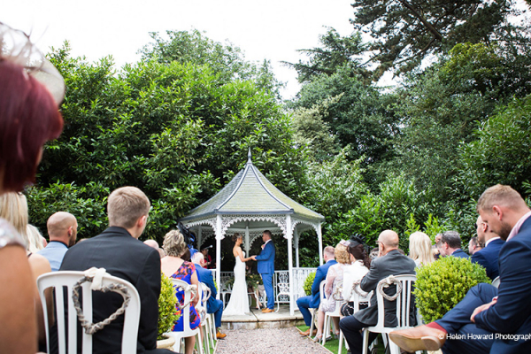 An outdoor wedding ceremony at Pendrell Hall wedding venue in Staffordshire | CHWV