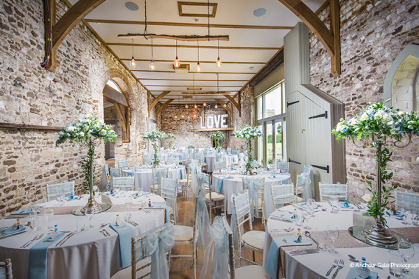 The Barn set up for a wedding breakfast at Pentney Abbey wedding venue in Norfolk | CHWV