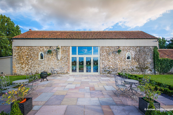 The Barn and courtyard at Pentney Abbey wedding venue in Norfolk | CHWV