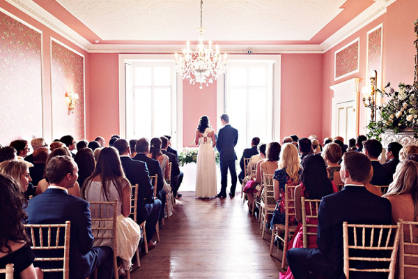 A wedding ceremony in the ballroom at Penton Park wedding venue in Hampshire | CHWV