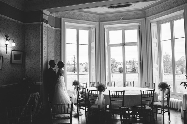 A couple take a moment in the drawing room at Penton Park wedding venue in Hampshire | CHWV