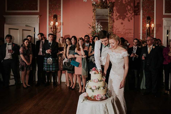 A couple cutting their cake at Penton Park wedding venue in Hampshire | CHWV
