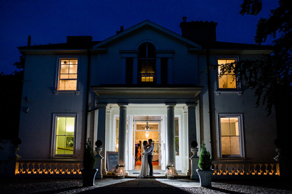 Penton Park wedding venue in Hampshire lit up in the evening | CHWV