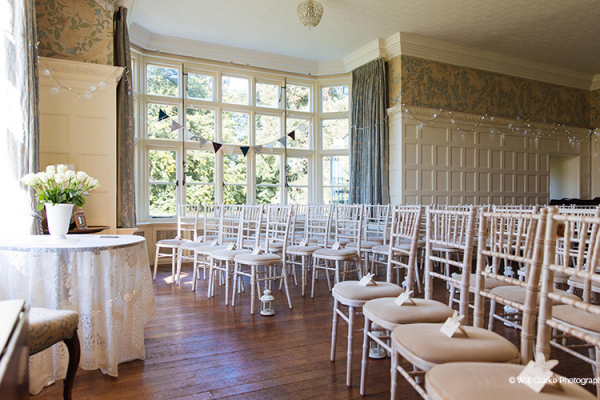 Set up for a ceremony in the Drawing Room at Plas Dinam country house wedding venue in Carmarthenshire | CHWV