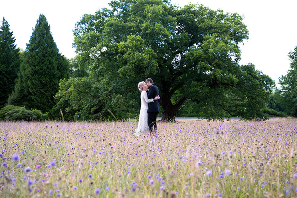 A happy couple taking a moment at Plas Dinam country house wedding venue in Carmarthenshire | CHWV