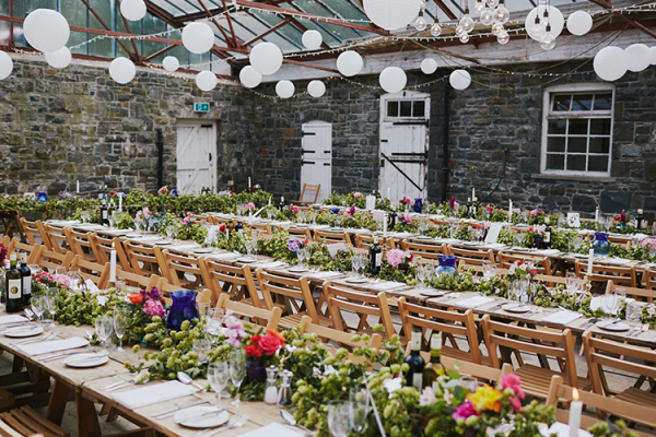 Set up for a wedding breakfast in the Stables at Plas Dinam country house wedding venue in Carmarthenshire | CHWV