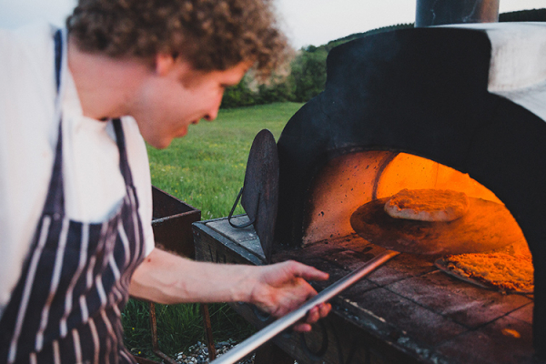 Cooking in the outdoor pizza oven at River Cottage