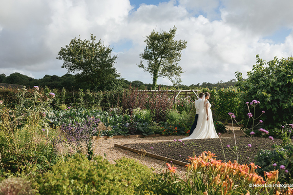 Taking a stroll in the beautiful gardens at River Cottage wedding venue in Devon | CHWV