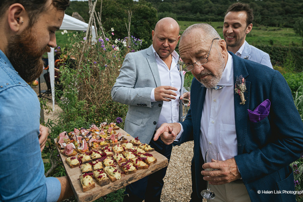 Canapes being served at a drinks reception at River Cottage wedding venue in Devon | CHWV