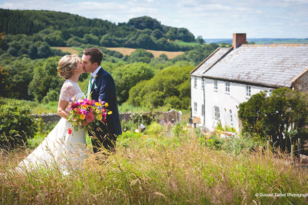 A happy couple taking a moment at River Cottage wedding venue in Devon | CHWV