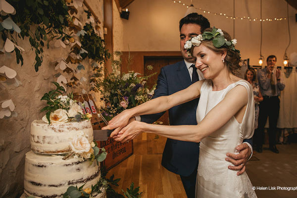 Cutting the cake at River Cottage wedding venue in Devon | CHWV