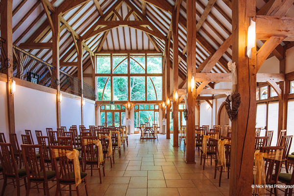 Set up for a wedding ceremony at Rivervale Barn wedding venue in Hampshire