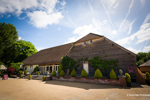 The barn in the sunshine at Rivervale Barn wedding venue in Hampshire | CHWV