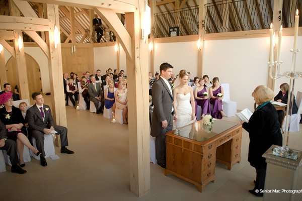 A wedding ceremony at Rivervale Barn