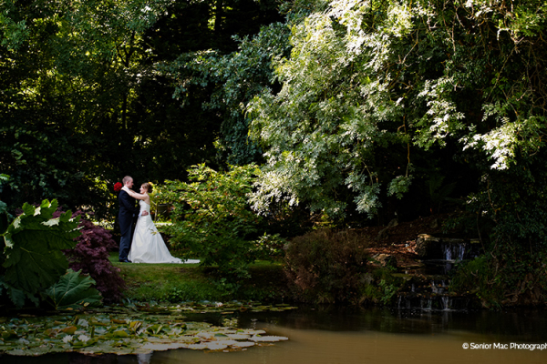 A happy couple in the grounds at Rivervale Barn