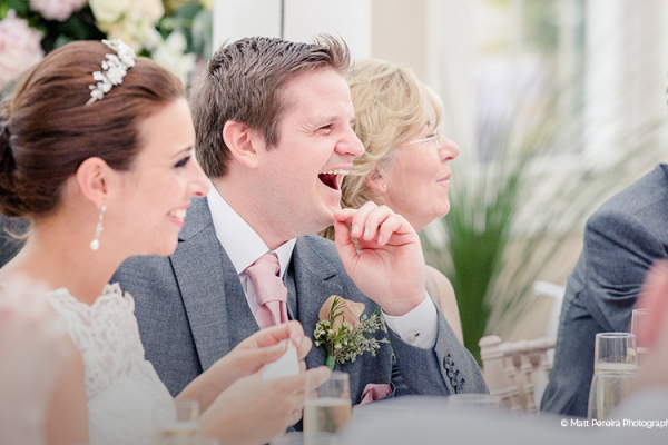 Enjoying the wedding breakfast inside the marquee at Robert Denholm House wedding venue in Surrey | CHWV