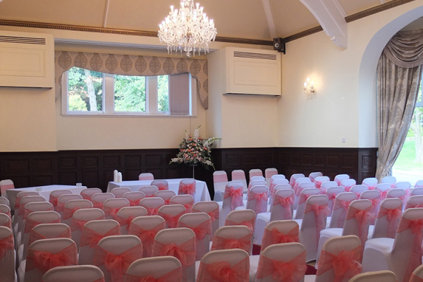 Set up for a ceremony at Robert Denholm House wedding venue in Surrey | CHWV