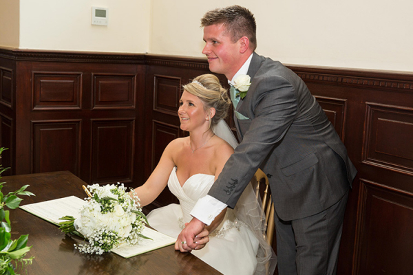 Signing the register at Robert Denholm House wedding venue in Surrey | CHWV