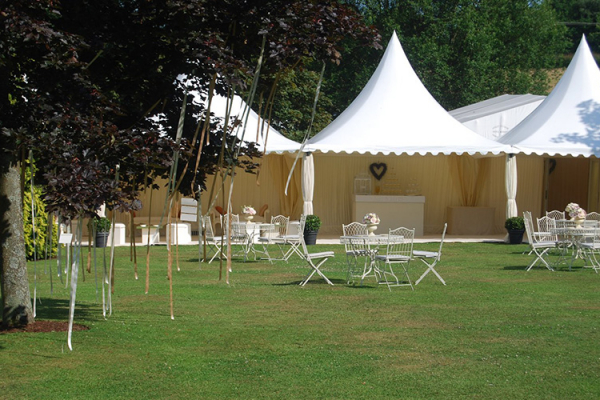 The marquee set up in the grounds at Robert Denholm House wedding venue in Surrey | CHWV