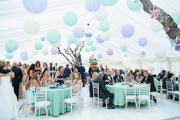 Wedding breakfast inside the marquee at Robert Denholm House wedding venue in Surrey | CHWV