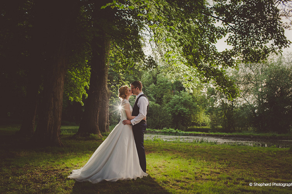 A happy couple in the beautiful grounds at Rowton Castle wedding venue in Shropshire | CHWV
