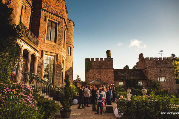 An outdoor drinks reception at Rowton Castle wedding venue in Shropshire | CHWV