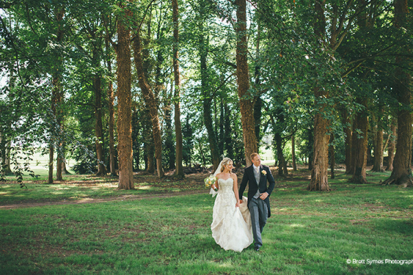 A couple taking a moment in the woods at Rowton Castle wedding venue in Shropshire | CHWV