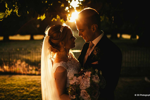 A couple taking a moment at sunset at Rowton Castle wedding venue in Shropshire | CHWV