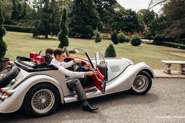 A groom arriving in style at Rowton Castle wedding venue in Shropshire | CHWV
